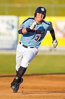 Rebel Ridling #37 of the Tennessee Smokies legs out a triple in the bottom of the 2nd inning against the Jackson Generals at Smokies Park on April 14, 2012 in Kodak, Tennessee.  The Smokies defeated the Generals 5-2.  (Brian Westerholt/Four Seam Images)