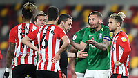 Birmingham captain, Harlee Dean can't believe referee, Dean Whitestone, has awarded a free-kick against his team during Brentford vs Birmingham City, Sky Bet EFL Championship Football at the Brentford Community Stadium on 6th April 2021