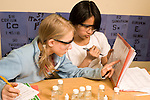 Education middle school Grade 7 science class lab students at work horizontal two girls working together