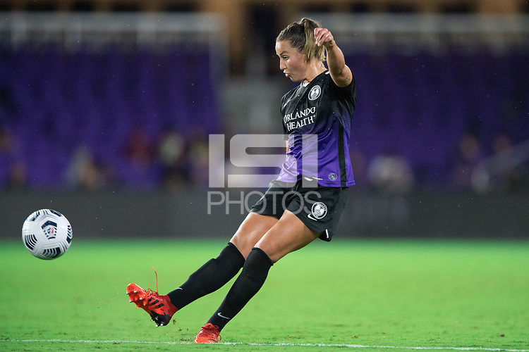 ORLANDO, FL - SEPTEMBER 11: Amy Turner #4 of the Orlando Pride kicks the ball during a game between Racing Louisville FC and Orlando Pride at Exploria Stadium on September 11, 2021 in Orlando, Florida.