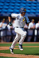 Michigan Wolverines catcher Harrison Salter (11) runs to first base on a base hit during a game against Army West Point on February 18, 2018 at Tradition Field in St. Lucie, Florida.  Michigan defeated Army 7-3.  (Mike Janes/Four Seam Images)