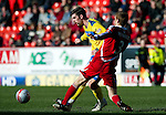 Aberdeen v St Johnstone....19.02.12   SPL.Cillian Sheridan is tackled by Mark Reynolds.Picture by Graeme Hart..Copyright Perthshire Picture Agency.Tel: 01738 623350  Mobile: 07990 594431