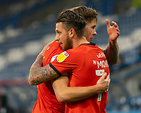 7th November 2020 The John Smiths Stadium, Huddersfield, Yorkshire, England; English Football League Championship Football, Huddersfield Town versus Luton Town; George Moncur of Luton Town congratulated by James Collins of Luton Town after his first half opening goal