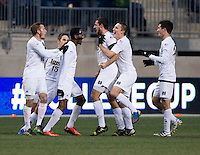 Andrew O'Malley (12) of Notre Dame celebrates his goal with Leon Brown (9) and other teammates during the NCAA Men's College Cup final at PPL Park in Chester, PA.  Notre Dame defeated Maryland, 2-1.