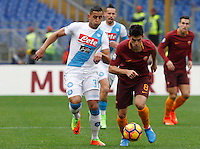 Roma's Diego Perotti, right,is challenged by Napoli's Faouzi Ghoulam during the Italian Serie A football match between Roma and Napoli at Rome's Olympic stadium, 4 March 2017. <br /> UPDATE IMAGES PRESS/Riccardo De Luca