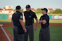 Umpires Brock Ballou, Emil Jimenez, and Tyler Jones (L-R) before a Southern League game between the Biloxi Shuckers and Pensacola Blue Wahoos on May 3, 2019 at Admiral Fetterman Field in Pensacola, Florida.  Pensacola defeated Biloxi 10-8.  (Mike Janes/Four Seam Images)