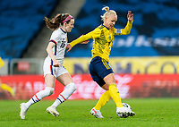 SOLNA, SWEDEN - APRIL 10: Rose Lavelle #16 of the USWNT defends Caroline Seger #17 of Sweden during a game between Sweden and USWNT at Friends Arena on April 10, 2021 in Solna, Sweden.