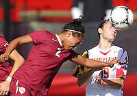 COLLEGE PARK, MD - OCTOBER 21, 2012:  Becky Kaplan (19) of the University of Maryland heads the ball with Ines Jaurena (2) of Florida State during an ACC women's match at Ludwig Field in College Park, MD. on October 21. Florida won 1-0.