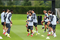 14th September 2021: The  AXA Training Centre, Kirkby, Knowsley, Merseyside, England: Liverpool FC training ahead of Champions League game versus AC Milan on 15th September: Mohammed Salah of Liverpool  warms up with his team mates