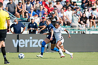 CARY, NC - SEPTEMBER 12: Kaleigh Kurtz #3 of the NC Courage and Crystal  Dunn #19 of the Portland Thorns battle for the ball during a game between Portland Thorns FC and North Carolina Courage at Sahlen's Stadium at WakeMed Soccer Park on September 12, 2021 in Cary, North Carolina.