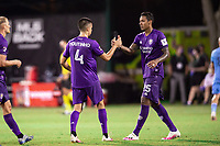 LAKE BUENA VISTA, FL - JULY 14: Joao Moutinho #4 and Antonio Carlos #25 of Orlando City SC celebrate a win during a game between Orlando City SC and New York City FC at Wide World of Sports on July 14, 2020 in Lake Buena Vista, Florida.