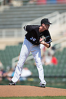 Kannapolis Intimidators relief pitcher Jack Charleston (25) looks to his catcher for the sign against the Lakewood BlueClaws at Kannapolis Intimidators Stadium on May 8, 2016 in Kannapolis, North Carolina.  The Intimidators defeated the BlueClaws 3-2.  (Brian Westerholt/Four Seam Images)