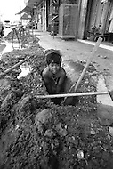Children at construction work in Bangkok, Thailand  - Child labor as seen around the world between 1979 and 1980 – Photographer Jean Pierre Laffont, touched by the suffering of child workers, chronicled their plight in 12 countries over the course of one year.  Laffont was awarded The World Press Award and Madeline Ross Award among many others for his work.