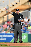 Umpire Christopher Stump signals a change during a game between the Aberdeen IronBirds and Williamsport Crosscutters on August 4, 2014 at Bowman Field in Williamsport, Pennsylvania.  Aberdeen defeated Williamsport 6-3.  (Mike Janes/Four Seam Images)