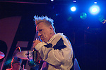 John Lydon taking a swig from a bottle while Public Image Limited playing at the Coal Exchange in Cardiff Bay tonight..Editorial use only - Exclusive to Rex - not sent anywhere.