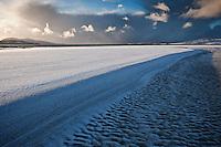 Snow coveres sand at Luskentyre beach, Isle of Harris, Western Isles, Scotland