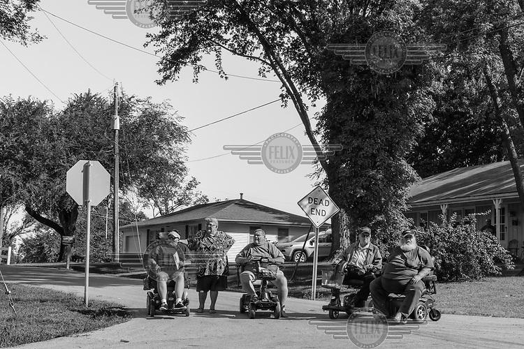 Spectators line the street at Jesse James Festival Parade.