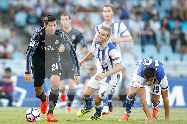 Real Sociedad's Inigo Martinez (c) and Yuri Berchiche (r) and Real Madrid's Alvaro Morata during La Liga match. August 21,2016. (ALTERPHOTOS/Acero)