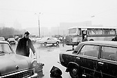 "Moscow, Russia<br /> October 22, 1992<br /> <br /> The parking lot of Kievski train station. <br /> <br /> In December 1991, food shortages in central Russia had prompted food rationing in the Moscow area for the first time since World War II. Amid steady collapse, Soviet President Gorbachev and his government continued to oppose rapid market reforms like Yavlinsky's ""500 Days"" program. To break Gorbachev's opposition, Yeltsin decided to disband the USSR in accordance with the Treaty of the Union of 1922 and thereby remove Gorbachev and the Soviet government from power. The step was also enthusiastically supported by the governments of Ukraine and Belarus, which were parties of the Treaty of 1922 along with Russia.<br /> <br /> On December 21, 1991, representatives of all member republics except Georgia signed the Alma-Ata Protocol, in which they confirmed the dissolution of the Union. That same day, all former-Soviet republics agreed to join the CIS, with the exception of the three Baltic States."