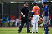 GCL Astros manager Wladimir Sutil (11) argues a call with umpire Chad Westlake during a Gulf Coast League game against the GCL Mets on August 10, 2019 at FITTEAM Ballpark of the Palm Beaches Training Complex in Palm Beach, Florida.  GCL Astros defeated the GCL Mets 8-6.  (Mike Janes/Four Seam Images)