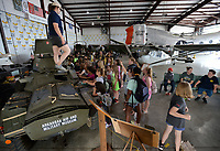 Laci Shuffield, director of the Arkansas Air and Military Museum, shows the features of a Daimler Ferret armored car Thursday, June 10, 2021, for a large group of students from Alma. The students are participants in Camp Airedale, a three-week summer camp focused on experiences and relationship building for students in the school district that features a field trip each week. Visit nwaonline.com/210611Daily/ for today's photo gallery.<br /> (NWA Democrat-Gazette/Andy Shupe)
