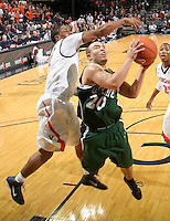 Nov. 15, 2010; Charlottesville, VA, USA; Virginia Cavaliers guard Jontel Evans (1) defends USC Upstate Spartans guard Josh Chavis (20) during the game at the John Paul Jones Arena. Virginia won 74-54. Mandatory Credit: Andrew Shurtleff