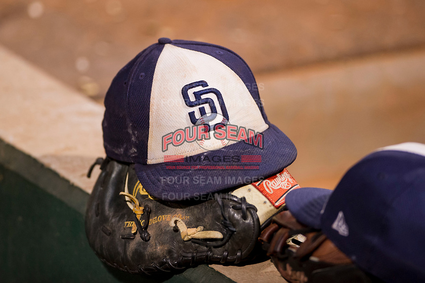 Hat of the AZL Padres, Arizona League Rookie affiliate of the San Diego Padres, rests on top a catchers mitt during a game between the AZL Padres and the AZL Indians on August 30, 2017 at Goodyear Ball Park in Goodyear, Arizona. AZL Padres defeated the AZL Indians 7-6. (Zachary Lucy/Four Seam Images)