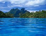 Bora Bora, French Polynesia: <br /> Bora Bora's volcanic Mts Hue, Pahia and Otemanu tower above Motu Toopua, Motu Toopua Iti and blue tropical lagoon