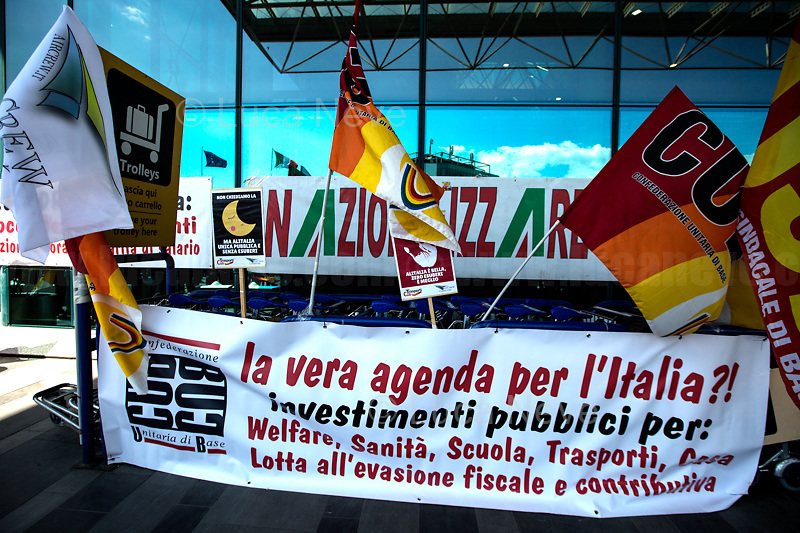 Rome, Italy. 23rd Apr, 2021. Today, Alitalia, air transport, Airports, logistic, and related workers, led by USB, CUB Trasporti Trade Unions, and supported by the Mayor of Fiumicino, held a protest outside the Terminal 3 of Rome's Fiumicino Airport (main Rome's Airport also known as Leonardo Da Vinci Airport). The aims of the demo were to protest against the plan, under discussion between Mario Draghi's Italian Government and the European Union (EU - UE), to dismantle the flag carrier of Italy, Alitalia, make it a small and regional airline with a different name - while it is still one of the biggest airport slots owner in the world -, and to lay-off the majority of the workers - about 11,000 - of the Italian historical air company. At the end of the demo protesters, patrolled by a conspicuous number of police officers, were allowed to demonstrate outside the Alitalia HQ near the airport.   <br />