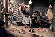 Children at work in a butcher shop.  Fez, Morocco  - Child labor as seen around the world between 1979 and 1980 - Photographer Jean Pierre Laffont, touched by the suffering of child workers, chronicled their plight in 12 countries over the course of one year.  Laffont was awarded The World Press Award and Madeline Ross Award among many others for his work.