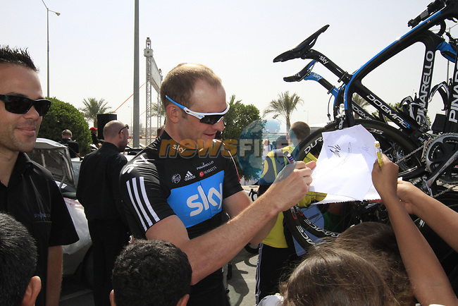 Sky Procycling rider Ian Stannard (GBR) signs autographs for local school children before the start of the 3rd Stage of the 2012 Tour of Qatar running 146.5km from Dukhan Souq, Dukhan to Al Gharafa, Qatar. 7th February 2012.<br /> (Photo Eoin Clarke/Newsfile)