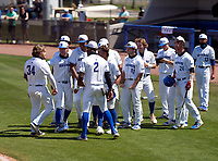 IMG Academy Ascenders Tommy White (34) celebrates hitting a home run with teammates - including Blaydon Plain (12), James Wood (23), Elijah Green (2), Max Galvin (17), Mason Albright (11) - during a game against the Calvary Christian Academy Eagles on March 13, 2021 at IMG Academy in Bradenton, Florida.  (Mike Janes/Four Seam Images)