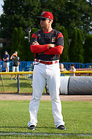 Batavia Muckdogs manager Mike Jacobs (28) watches the team warmup before a game against the Auburn Doubledays on June 19, 2017 at Dwyer Stadium in Batavia, New York.  Batavia defeated Auburn 8-2 in both teams opening game of the season.  (Mike Janes/Four Seam Images)