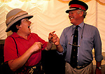Country House Auction at Newnham Hall Northamptonshire 1994. Chritsies auction 1990s ROSINA & PETER STEER FOOLING AROUND WITH SOME HATS,