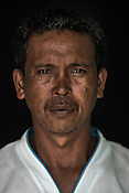 43 year old Tuna fisherman, Buddy Diocarisa poses for a portrait at the Casa, the Tuna buying house in Puerto Princesa, Palawan in the Philippines. <br /> Photo: Sanjit Das/Panos for Greenpeace