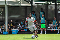 LAKE BUENA VISTA, FL - JULY 13: Ayo Akinola #20 of Toronto FC dribbles the ball during a game between D.C. United and Toronto FC at Wide World of Sports on July 13, 2020 in Lake Buena Vista, Florida.