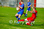 Tralee Dynamos Rob Lynch puts in a challenge on Ian Prendergast of Killarney Athletic in the Denny Premier A soccer league game