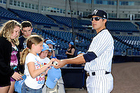 Tampa Yankees catcher Hector Rabago #22 signs autographs before a game against the Lakeland Flying Tigers at Steinbrenner Field on April 6, 2013 in Tampa, Florida.  Lakeland defeated Tampa 8-3.  (Mike Janes/Four Seam Images)
