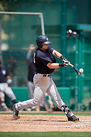 GCL Yankees West third baseman Mitchell Robinson (34) swings at a pitch during the first game of a doubleheader against the GCL Braves on July 30, 2018 at Champion Stadium in Kissimmee, Florida.  GCL Yankees West defeated GCL Braves 7-5.  (Mike Janes/Four Seam Images)