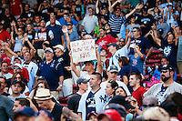 BOSTON, MASS. - SEPT. 28, 2014: Fans hold signs to get Derek Jeter's attention after the New York Yankees and Boston Red Sox played at Fenway Park. The game is last game of Derek Jeter's career. M. Scott Brauer for The New York Times