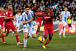 CD Leganes' Guido Marcelo Carrillo and Getafe CF's Djene Dakoman fight for the ball during La Liga match between CD Leganes and Getafe CF at Butarque Stadium in Leganes, Spain. December 07, 2018. (ALTERPHOTOS/A. Perez Meca)