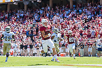 STANFORD, CA - AUGUST 30, 2014:  Christian McCaffrey scores a touchdown during Stanford's game against UC Davis. The Cardinal defeated the Aggies 45-0.