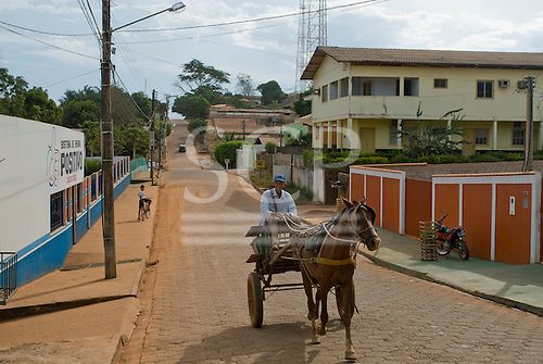 Pará State, Brazil. Tucumã. Horse and cart on a street.