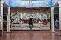Myanmar, Burma.   Buddhist Shrine in Meeting Hall, Thein Taung Paya monastery, Kalaw, Shan State.