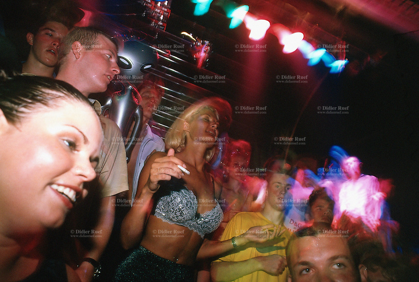 Spain. Ibiza in the Balearic islands. Ibiza. Night life. Disco Amnesia. The crowd dances on the sound of the techno music.  © 1999 Didier Ruef