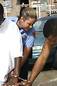 New Orleans police officer Jaimie Cohen arrest two men for driving a stolen car and possessing an illegal firearm, Nov. 17, 2004..(Cheryl Gerber photo)