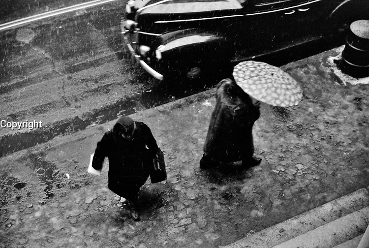 Torrential: On a rainy day in Providence, Rhode Island, December 1940.<br /> <br /> Photo by Jack Delano.