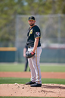 Pittsburgh Pirates starting pitcher Jake Barrett (90) looks in for the sign during a Minor League Spring Training game against the Philadelphia Phillies on March 13, 2019 at Pirate City in Bradenton, Florida.  (Mike Janes/Four Seam Images)