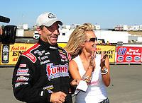 Jul. 31, 2011; Sonoma, CA, USA; NHRA pro stock driver Greg Anderson celebrates with wife Kim Anderson after winning the Fram Autolite Nationals at Infineon Raceway. Mandatory Credit: Mark J. Rebilas-
