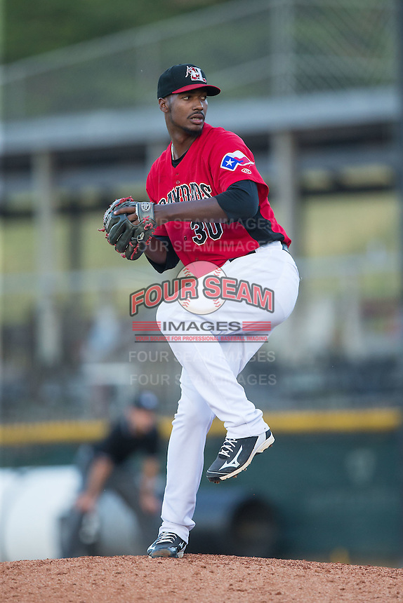 Hickory Crawdads relief pitcher David Perez (30) in action against the Savannah Sand Gnats at L.P. Frans Stadium on June 14, 2015 in Hickory, North Carolina.  The Crawdads defeated the Sand Gnats 8-1.  (Brian Westerholt/Four Seam Images)